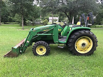 2000 John Deere model 4600 tractor with front loader and 6' Woods Brush cutter