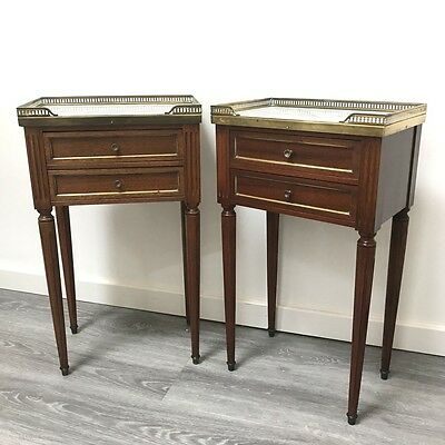 Pair of French mahogany and brass side tables with marble tops