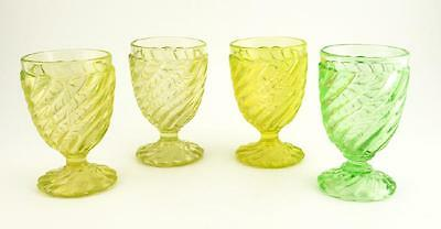 A set of 4 early 20th century Russian pressed uranium glass goblets