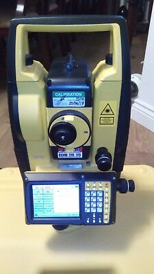 total station & wooden tripods