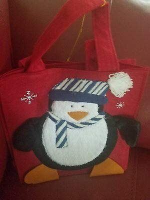 Avon penguin Christmas bagNew  .. there are two of these available