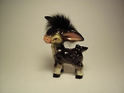 Vintage Donkey Foal With A Wispy Fly-away Forelock Between The Ears