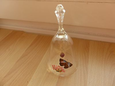 Collectors bell with a butterfly painted on clear glass and with a ruby red ding