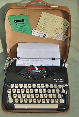"Vintage Olympia ""SPLENDID 99"" Portable Typewriter & Original Tan Carry Case"