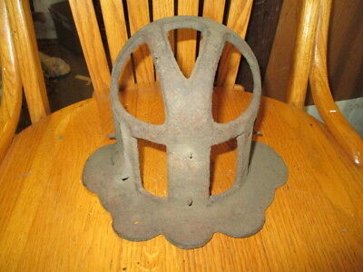 Antique cast iron protective light fixture grill/water spout cover?