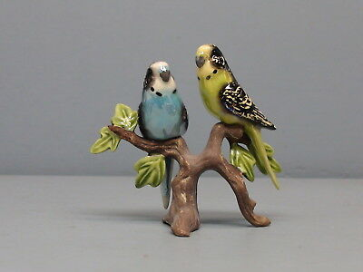 Retired Hagen Renaker Specialty Parakeets on Stoneware Branch