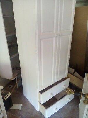 white painted wooden wardrobe with two drawers