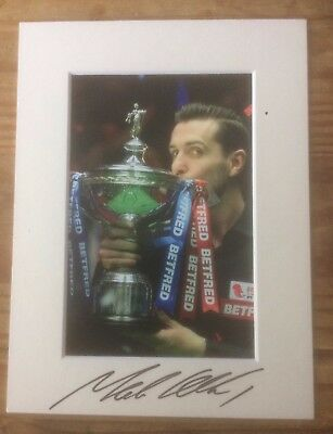 A 20 cm x 15 cm mount with photo signed by Snooker Player Mark Selby. (1).
