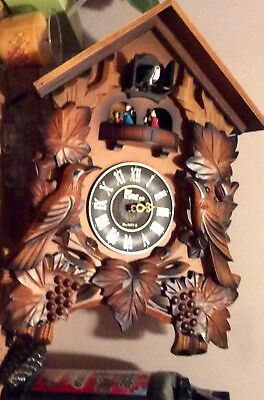 The Time Co. Cuckoo Clock For Parts have one of weights for the bottom