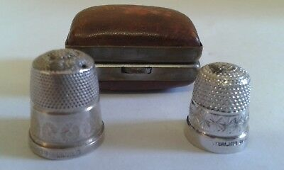 A Pair of Silver Thimbles - one with leather case - both post 1945.