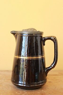 Antique Pewter lidded water jug.