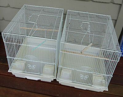 Two white bird cages (suit budgies)