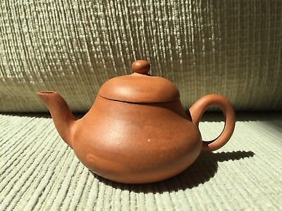 Old small chinese teapot and chinese marked below.