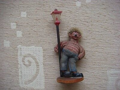 rare vintage drunk looking steiff hedgehog doll holding on to lamp post