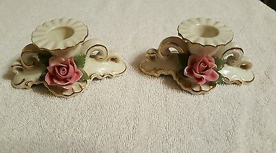 A vintage pair of Dresden porcelian  rose candlestick holder