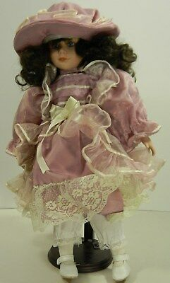 """Porcelain Doll 17"""" Brown Hair with Dress and Hat"""