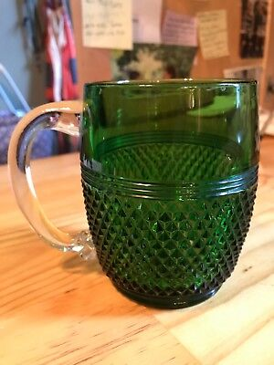 Three antique green glass mugs with clear glass handles