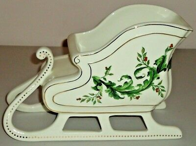 "CHRISTMAS SLEIGH Figurine white ceramic w/holly and gold accents 9""L x 6""H"