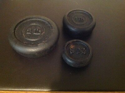 Set Of Three Cast Iron Weights - 2Lb, 1Lb, And 8Oz.
