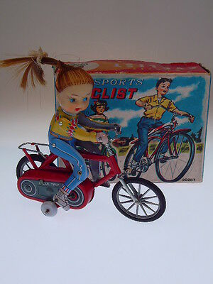 """GIRL SPORTS CYCLIST""  JAPAN,  15cm, FRITION OK, LIKE NEW/WIE NEU IN BOX !"