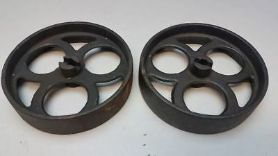 A pair of ANTIQUE VINTAGE INDUSTRIAL FACTORY CART CAST IRON WHEEL CASTERS