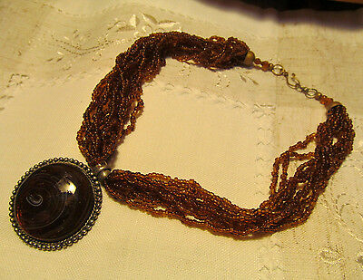 Vtg Caramel Brown Seed Bead Choker Necklace with Swirl Round Cabochon Pendant