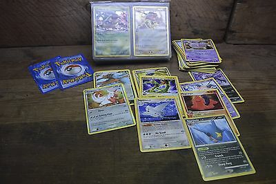 Pokemon Trading Cards In Cluding Holos Over 100 Mixed Cards