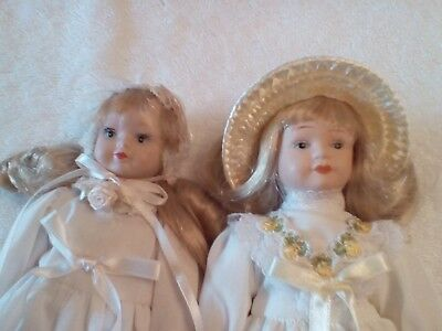 """porcelain dolls 8"""" Made in China face hands legs and feet porcelain"""