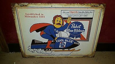 (L@@k) Pabst Blue Ribbon Beer Cool Blue Guy On Snowmobile Tin Sign Bar Game Room