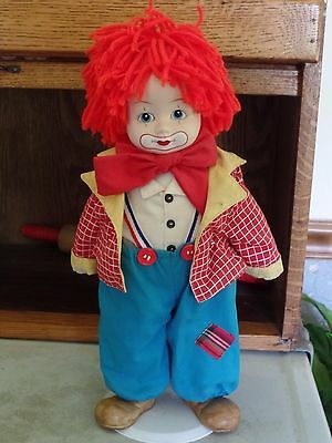 """Wind Up Musical Clown Doll Porcelain/ Cloth with Stand Red Yarn Hair 13"""""""