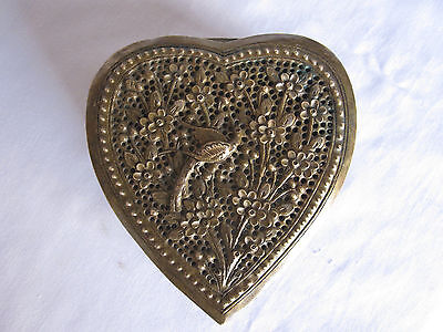 An old or vintage brass box MUGHAL OR ISLAMIC ART jali cutting heart shape.