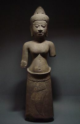 STANDING FIGURE OF A STONE FEMALE DEITY. KHMER ANGKOR PERIOD, BAYON STYLE 13th C