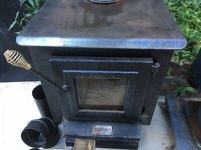 Pair of Wood Burning Stoves, One Made By Elmira Stove Works and Other Unknown