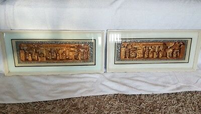 Two framed Chinese wood carvings