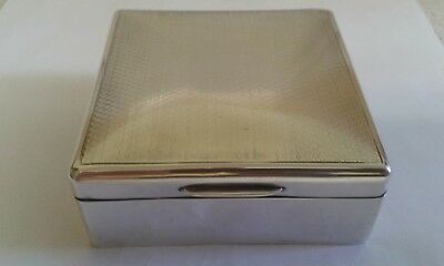 A Small Silver Cigarette Box with Engine Turned Lid - London 1923.