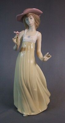 """Nao Figure Young Girl Holding A Single Flower 10 1/4"""" Tall"""