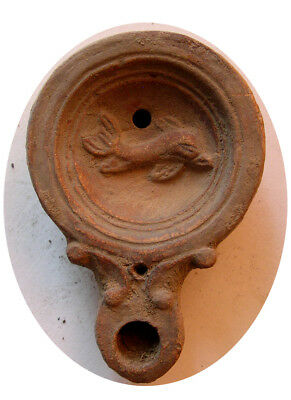 PCW-AN298-ROMAN EMPIRE. Ca. 1st-2nd Century AD. Terracotta Oil Lamp. Dolphin.