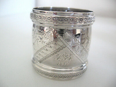 Very Ornate sterling silver napkin ring made in 1885.  Wood & Hughes, New York