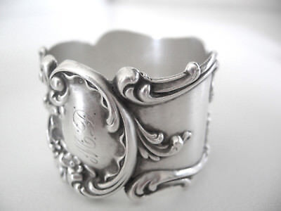 Outstanding sterling silver napkin ring .  Heavy applied art nouveau decorations