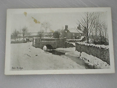Ford Bridge snow river and cottage Postcard