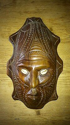 Hand carved wooden tribal mask-shell eyes
