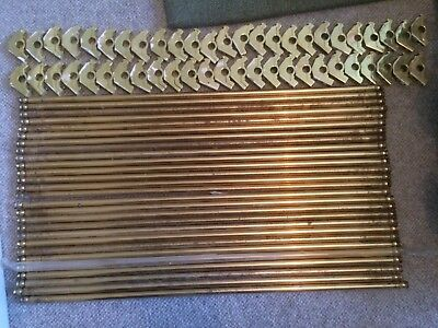 27 brass stair rods (64cm long) and 50 brackets