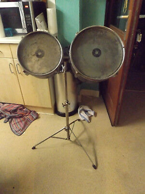 pair of black  hi tom drums with stand
