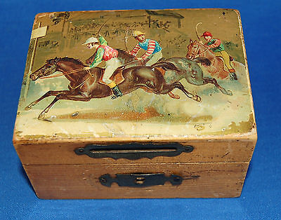 An antique wooden money box with decoupage horse racing image