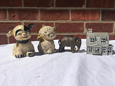 4 Vintage Cast Iron Coin Banks: Fido, Kitty, Elephant & House with porch