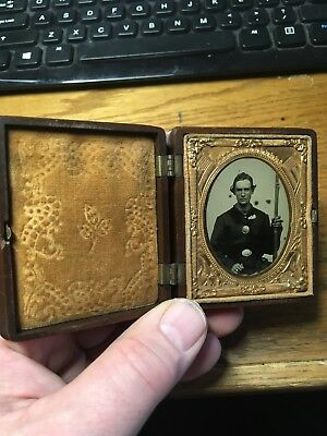 Armed 1/9 plate Ambrotype of a Union soldier in patriotic case. Beautiful image