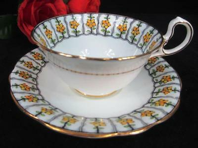 Antique 1925s Aynsley Yellow Floral Trellis D-handle Cup and Saucer