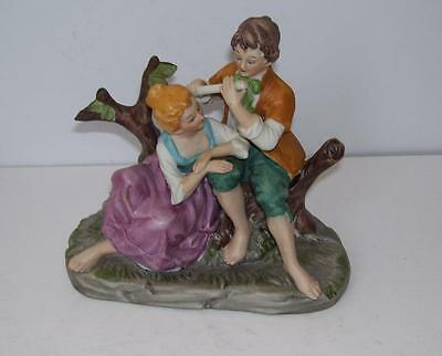 Retro Hand Painted Figure.Boy and Girl Sweethearts on a Tree Stump.