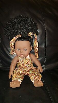 Black doll with afro