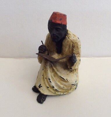 Antique cold hand painted metal figure of a nodding Arab 9cms high